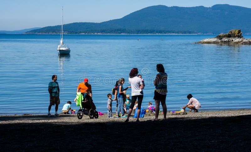 Families enjoying weekend at the seashore royalty free stock photography