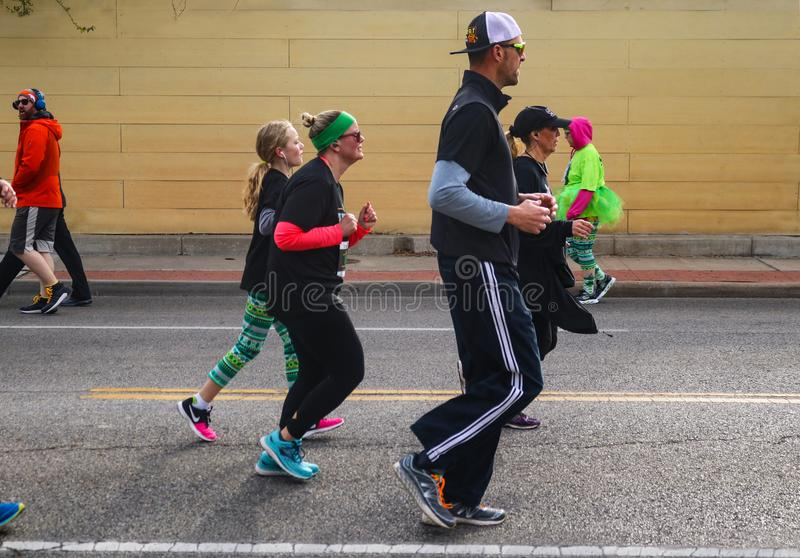 Families jog down Peoria Ave in St Patricks Day Parade in Tulsa Oklahoma USA 3 17 2018 stock photography