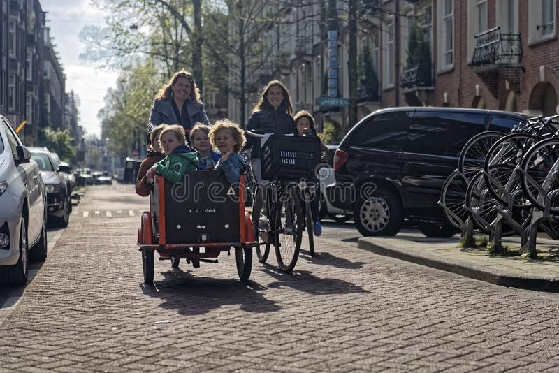 Families on bikes, Amsterdam, Holland stock images