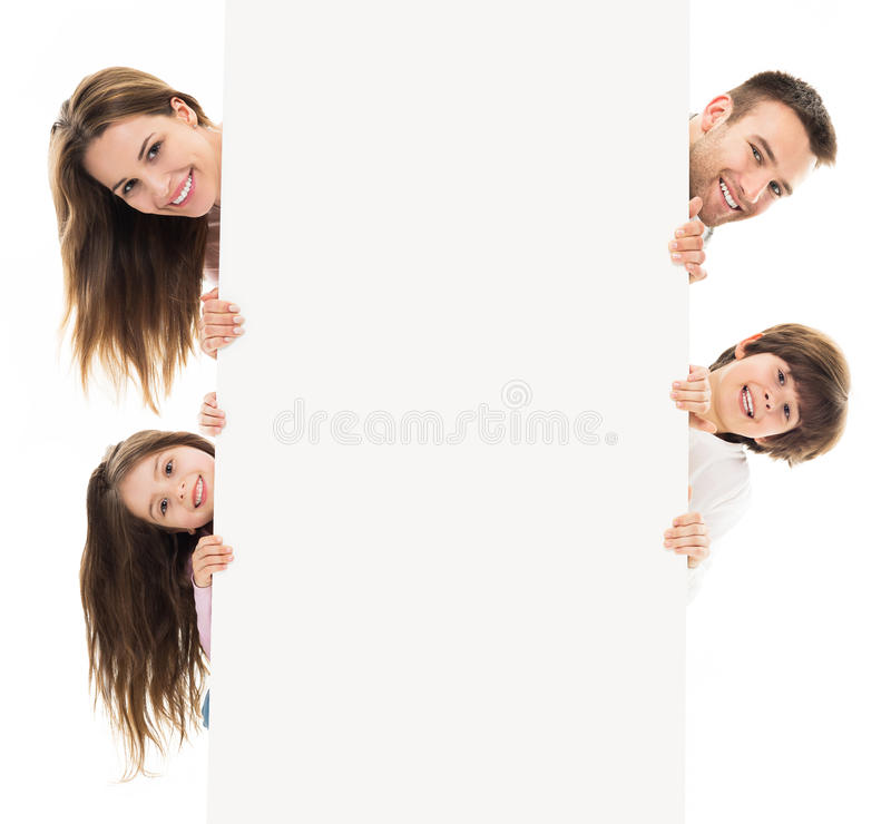 Familj med banret royaltyfri foto