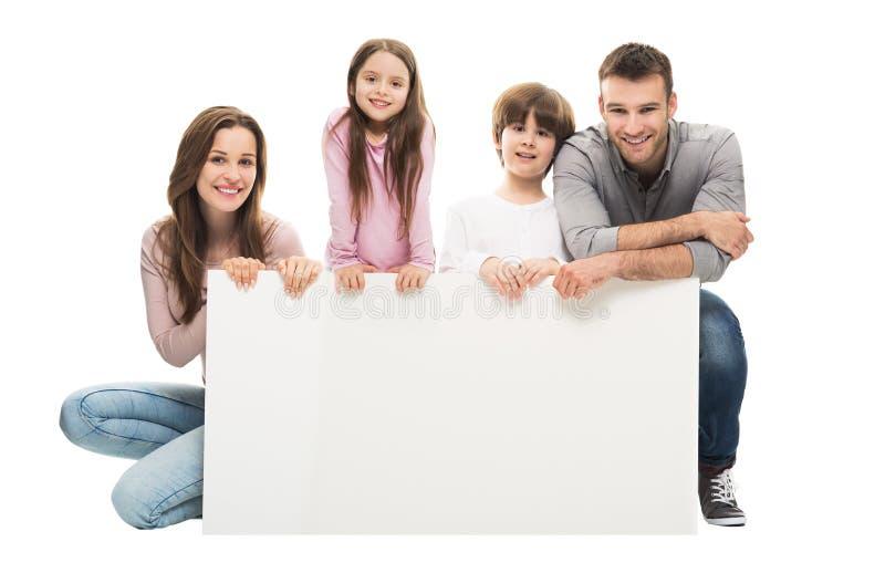 Familj med banret royaltyfri bild