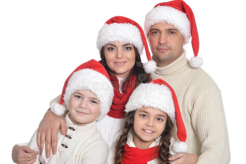 Familj med ungar i santa hattar arkivfoton