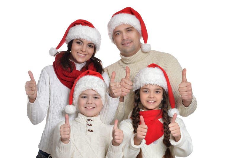 Familj med ungar med tummar upp royaltyfria bilder
