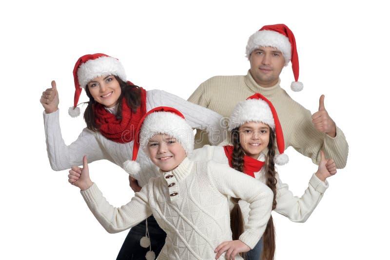 Familj med ungar med tummar upp på vit bakgrund arkivbilder