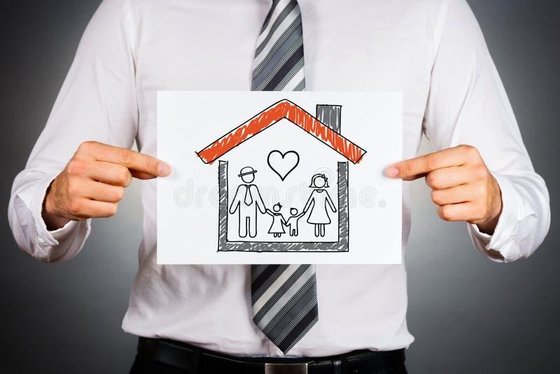 Familj och hem- försäkringbegrepp arkivbilder