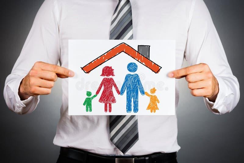 Familj och hem- försäkringbegrepp royaltyfri foto
