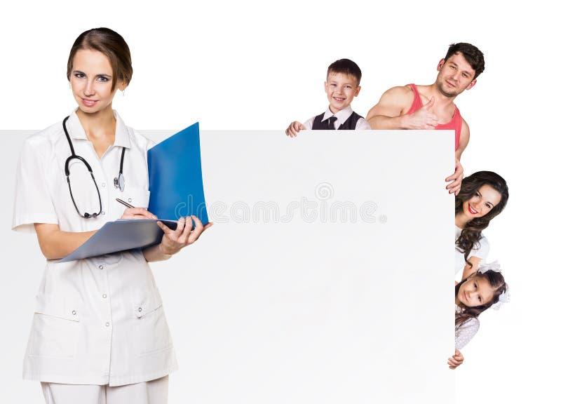 Familj på doktorstidsbeställningen arkivfoton