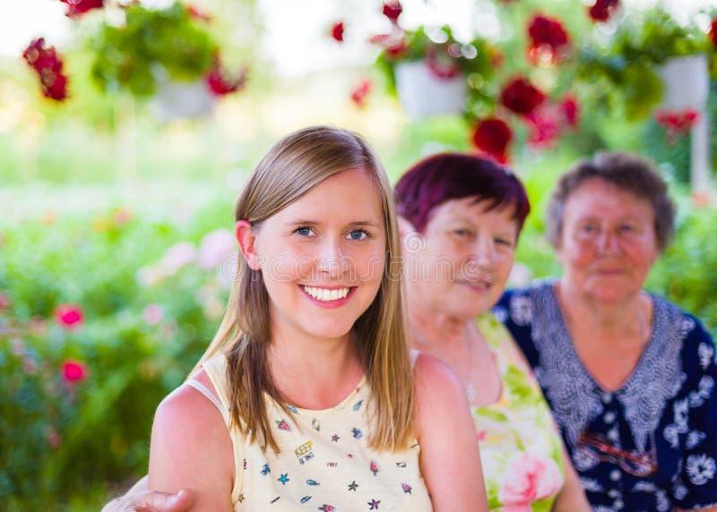 Familjen är första royaltyfri fotografi
