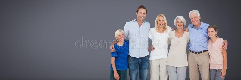 Familjutvecklingar samman med grå bakgrund royaltyfri fotografi