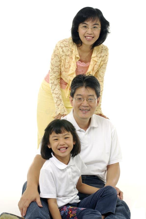 Download Famille asiatique image stock. Image du lifestyle, salon - 8670493