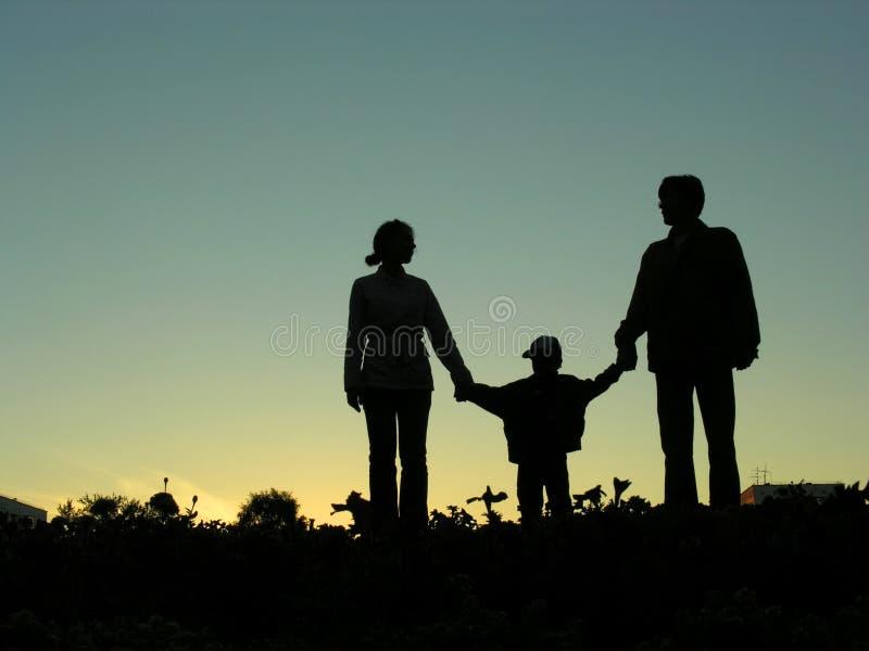 Famille avec la silhouette de garçon images libres de droits