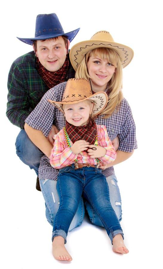 Famille dans des costumes de cowboy image libre de droits