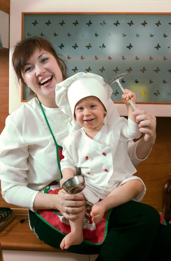 Famille de cuisinier images stock