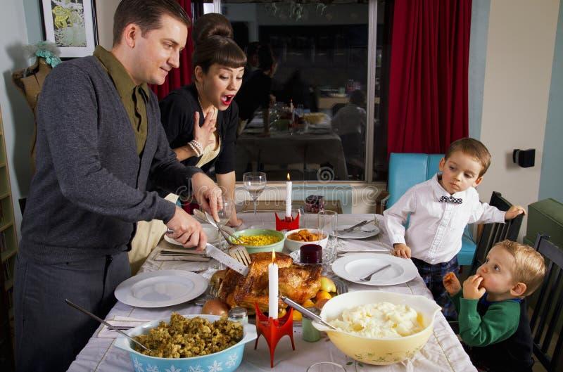 Famille de la Turquie de dîner de thanksgiving images stock