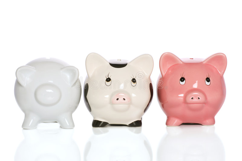 Famille de Piggybank photographie stock