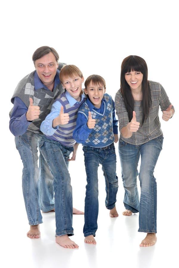 Famille de quatre joyeuse image stock