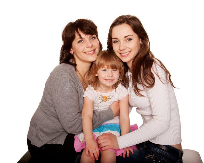 Famille de sourire heureuse, mère et deux filles photos stock
