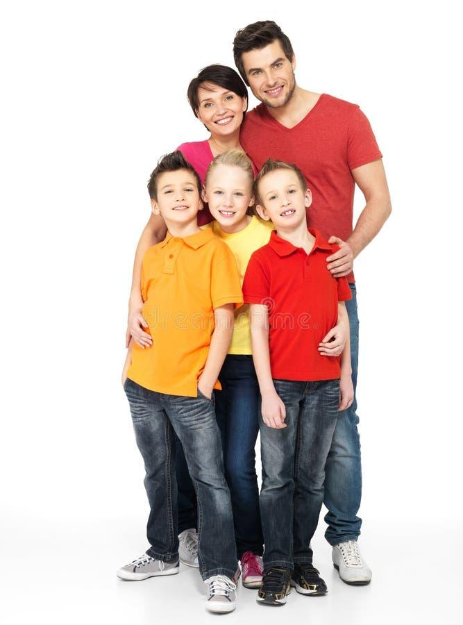 Famille heureuse avec deux enfants sur le blanc photo libre de droits