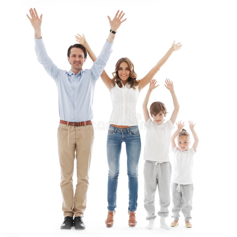 Famille heureuse avec les mains augment?es images libres de droits