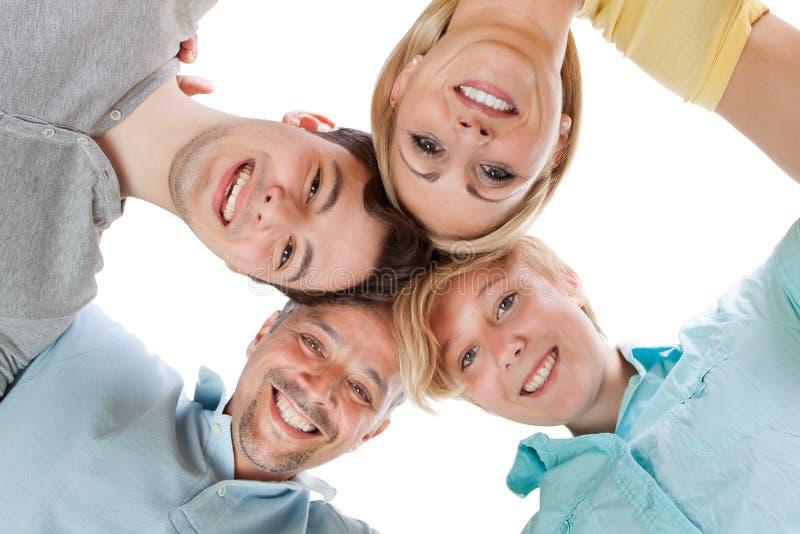 Famille heureuse regardant vers le bas photographie stock libre de droits