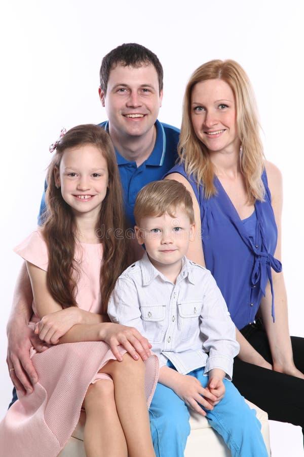 Famille sur le blanc image stock