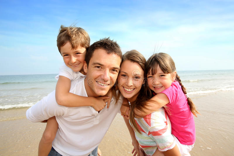 Familly standing on the beach royalty free stock photos