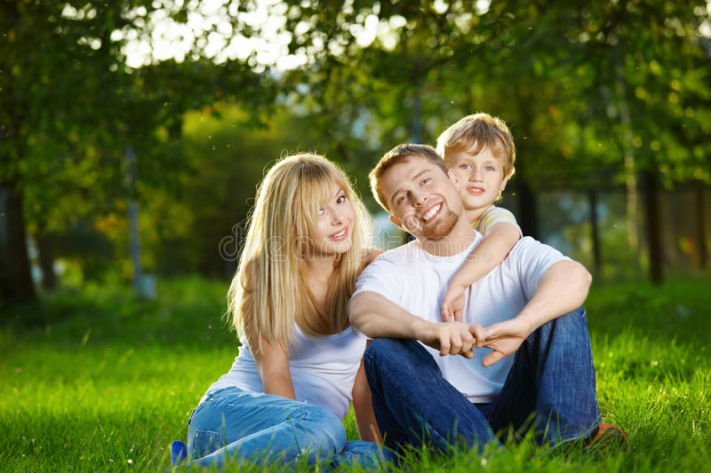 Family. Smiling family has rest on a summer lawn stock photography