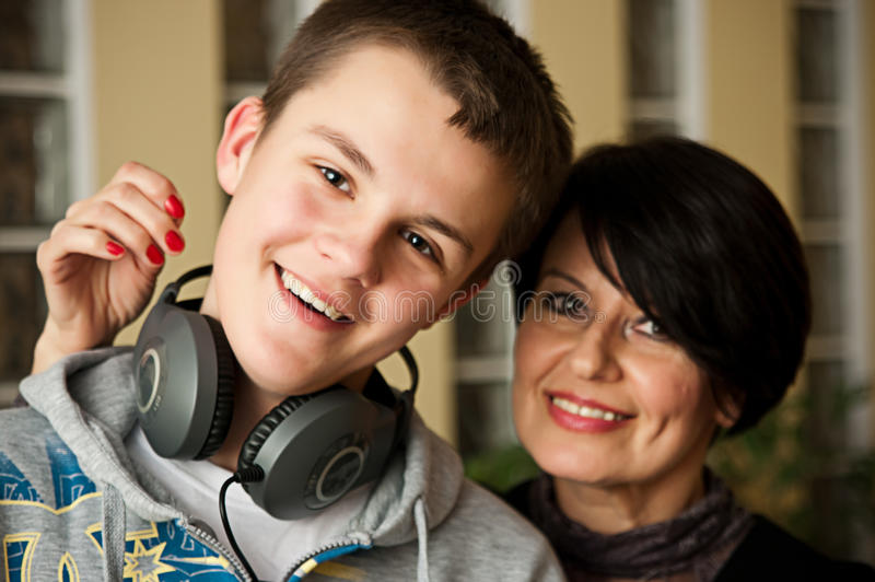 Family. Portrait of grandmother with her teenage grandson stock photography