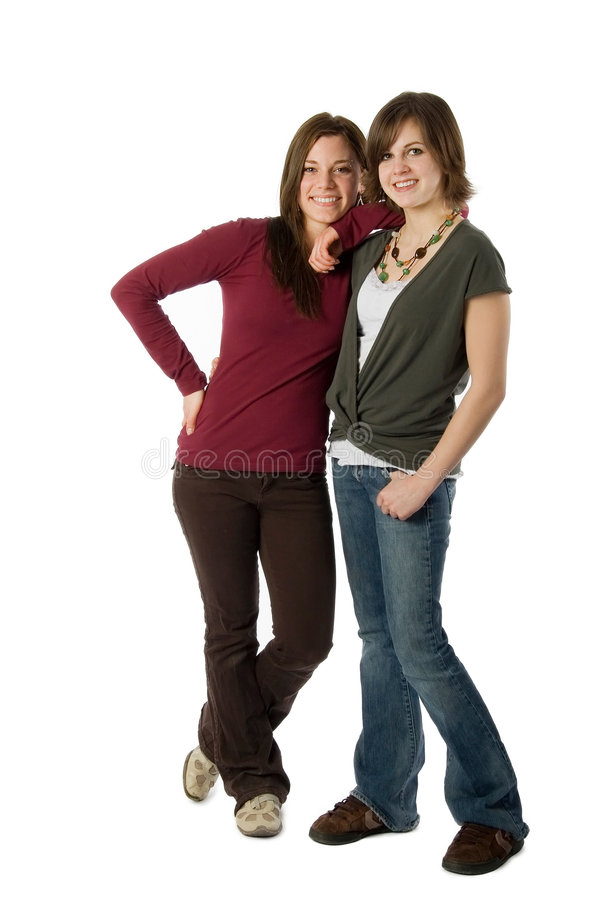 Family. Two teen girls standing isolated on white stock image