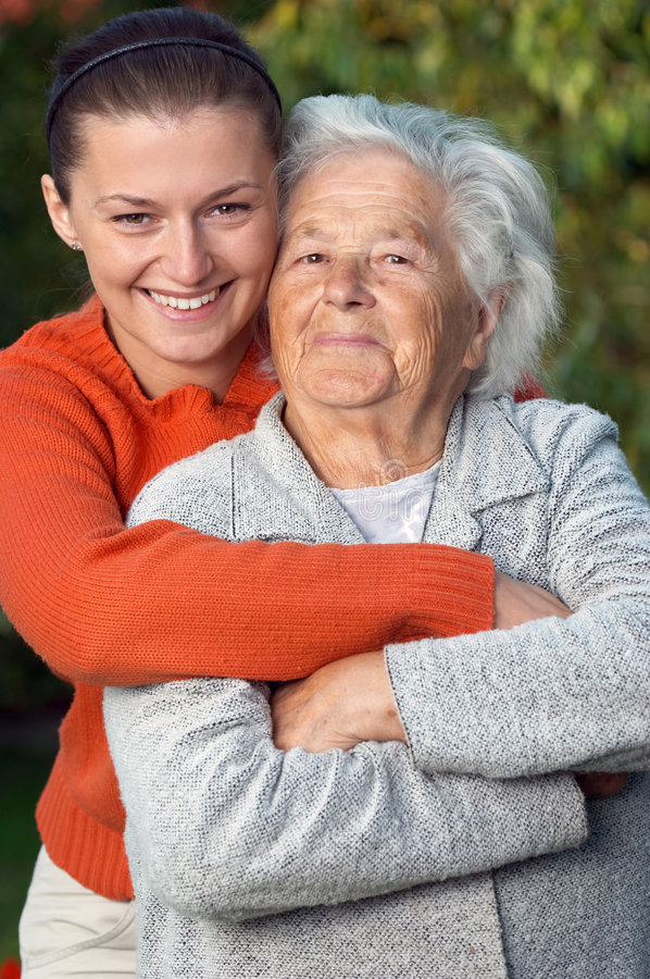 Family. Young woman embracing her grandmother stock photography