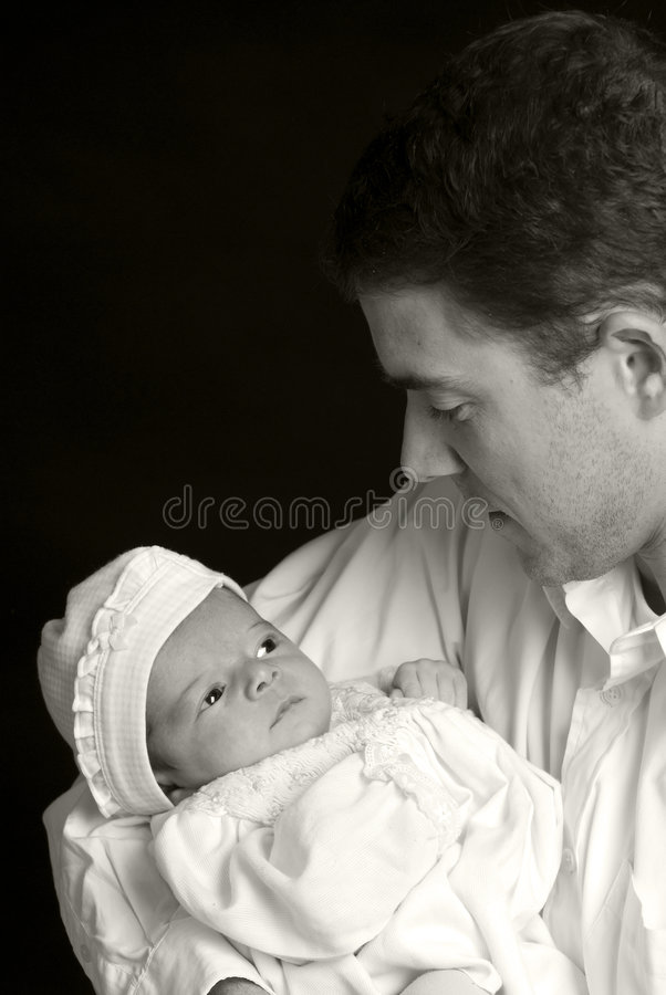 Family. A young man with a newborn girl. Family, love, caring stock images
