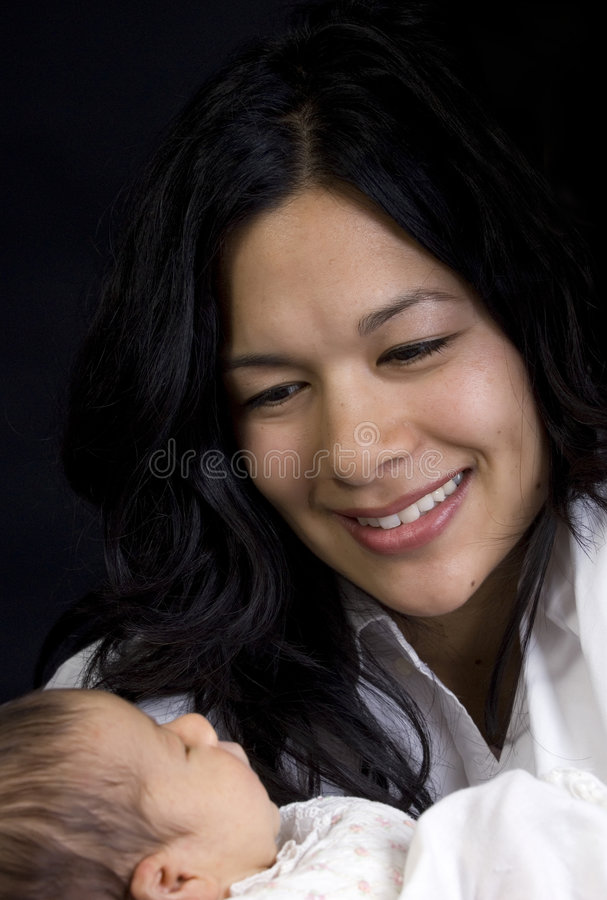 Family. A young woman with a newborn girl. Family, love, caring royalty free stock photo