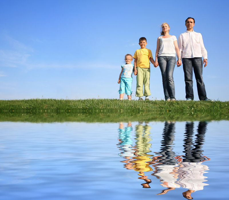 Family. Grass water on sky background