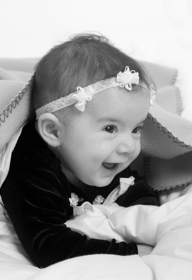 Family. A young newborn baby girl with a cute smile royalty free stock images