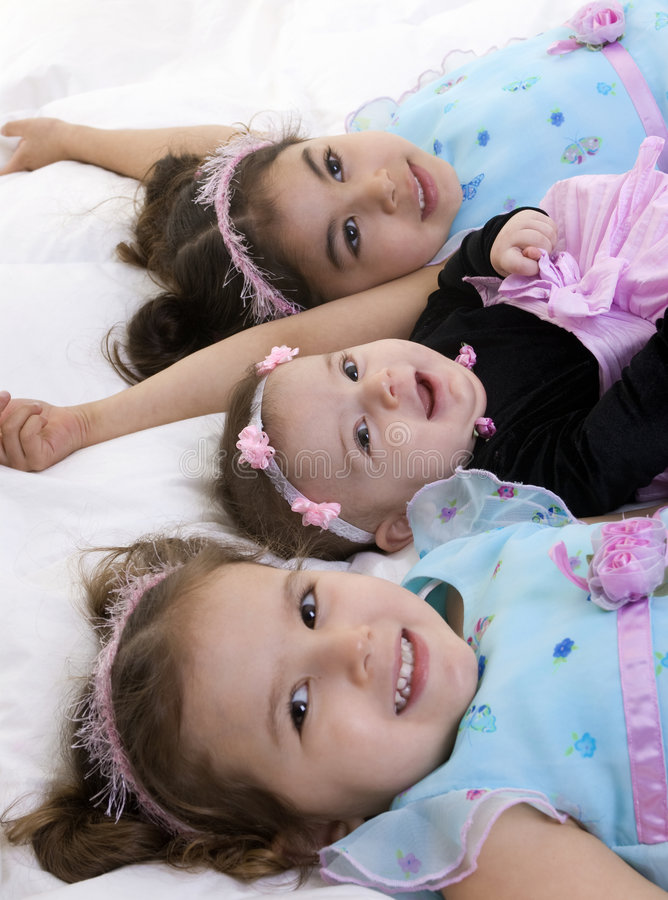 Family. Happy children smiling laying on a bed. Bonding, Love, childhood royalty free stock photos