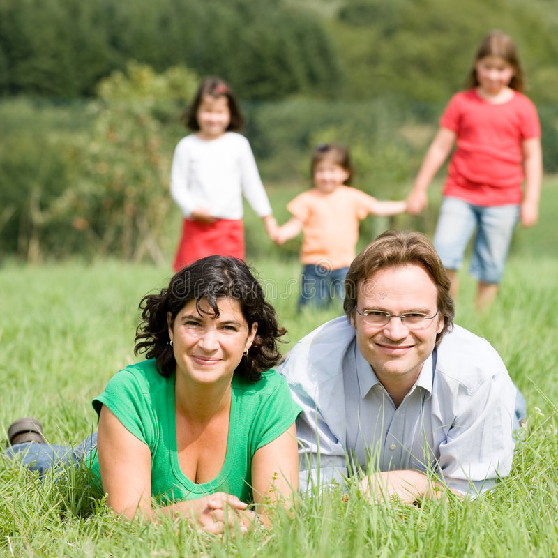 Family. Happy and young family in a farmers field