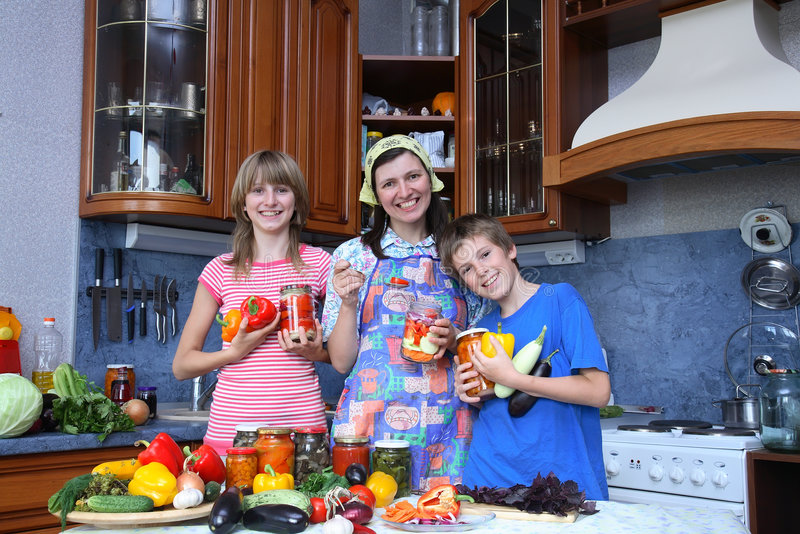 Family. Amicable family on modern kitchen stock photography