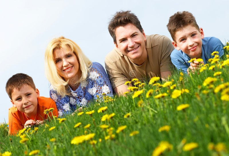 Family. Happy family. Father, mother and sons in the park royalty free stock images
