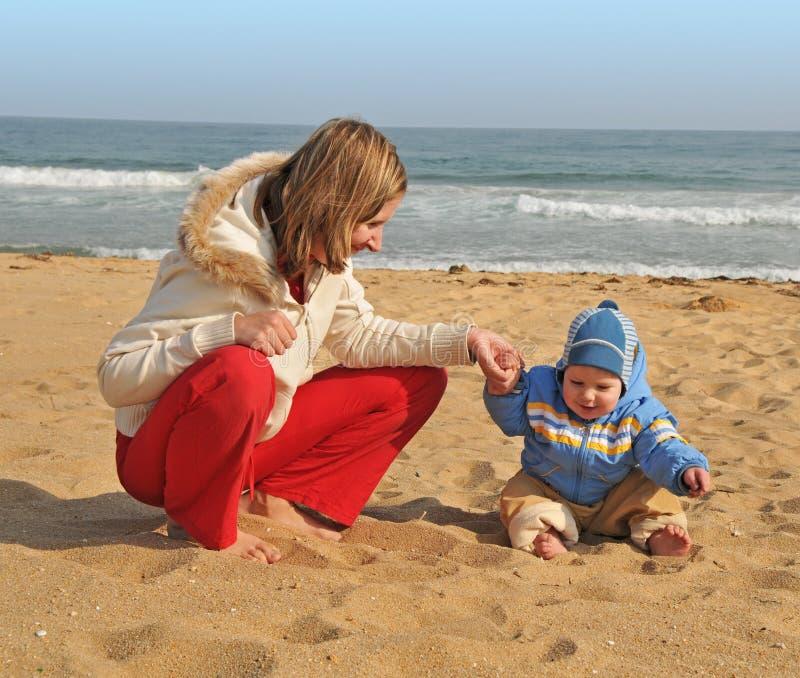 Family active vacation on the sea beach stock photography