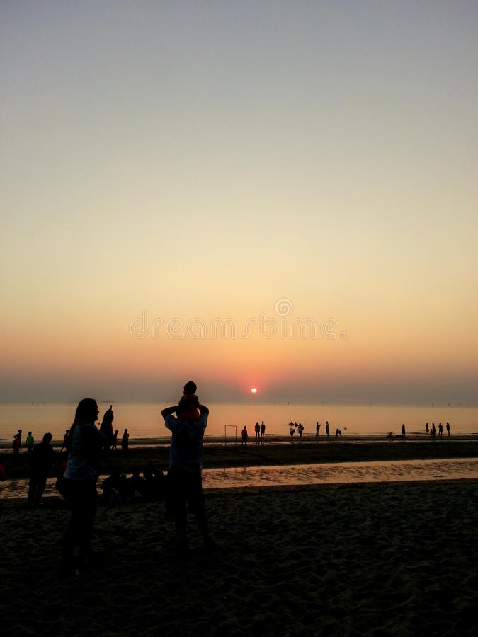 Family Activities on the Beach : Sunset. & happy time stock photography