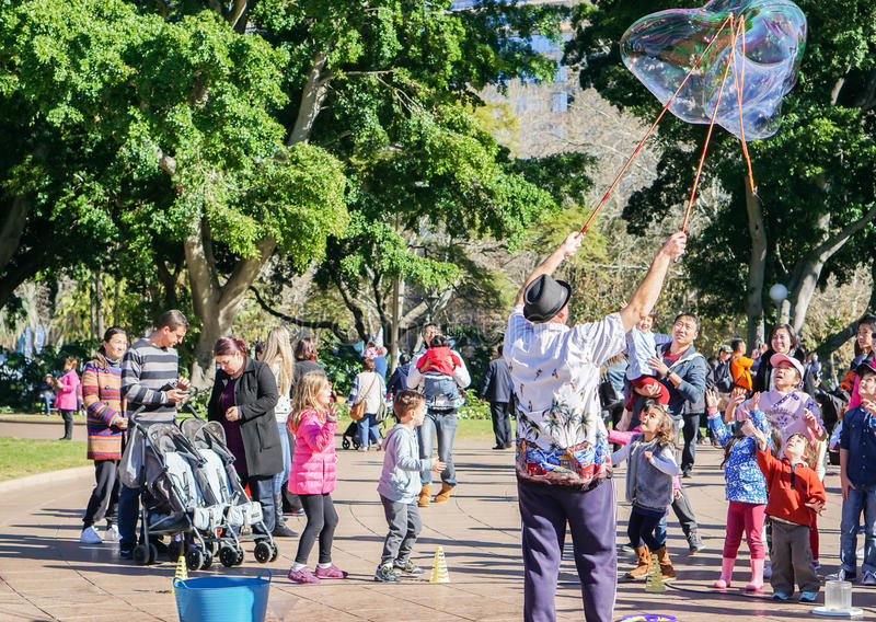 Family activities in Hyde Park on weekend taken in Sydney Australia. On 4 July 2016 royalty free stock photos