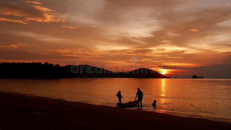 Family activities in Koh-Mak island. Family activities at Koh-Mak island in the evening stock image