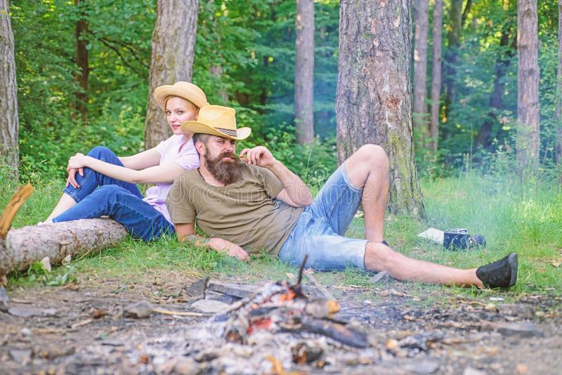 Family activity for summer vacation in forest and nature. Couple relaxing after gathering mushrooms in wild for food royalty free stock image