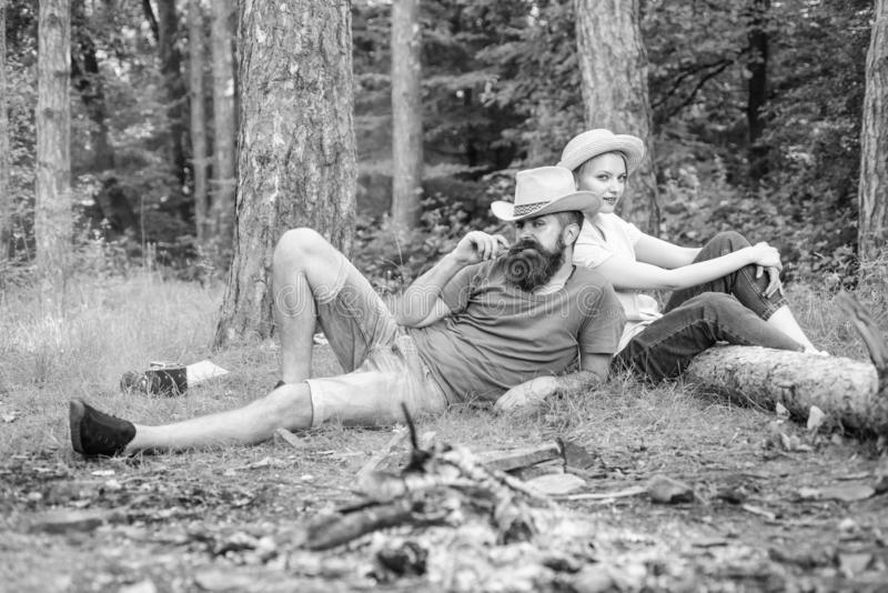 Family activity for summer vacation in forest and nature. Couple relaxing after gathering mushrooms in wild for food royalty free stock images