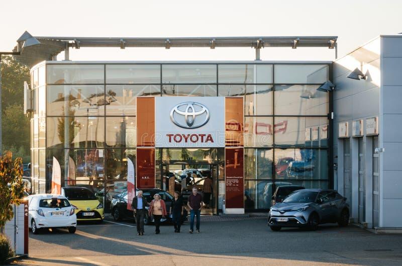 Family adults senior exiting toyota car showroom royalty free stock photos