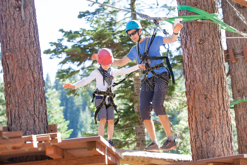 Family at adventure park stock photos