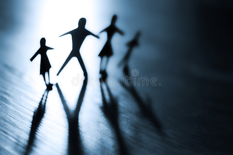 A Family Affair. Conceptual photography of a paper family