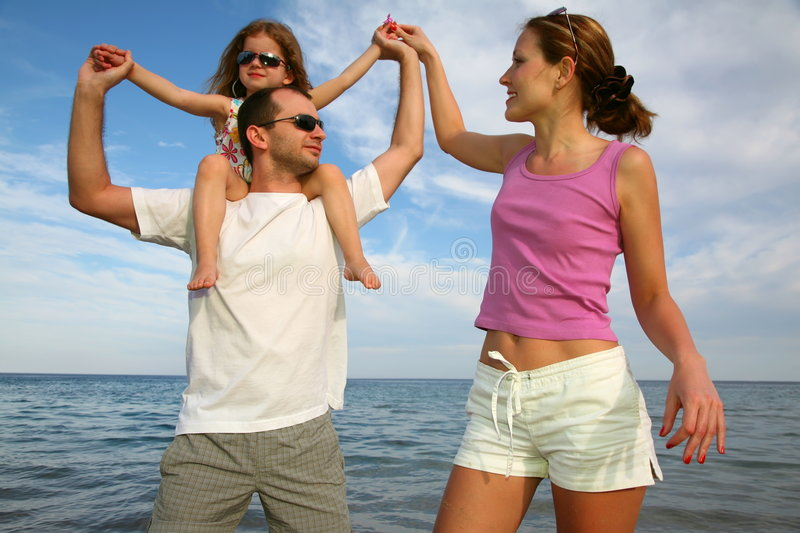 Family against a sea stock image