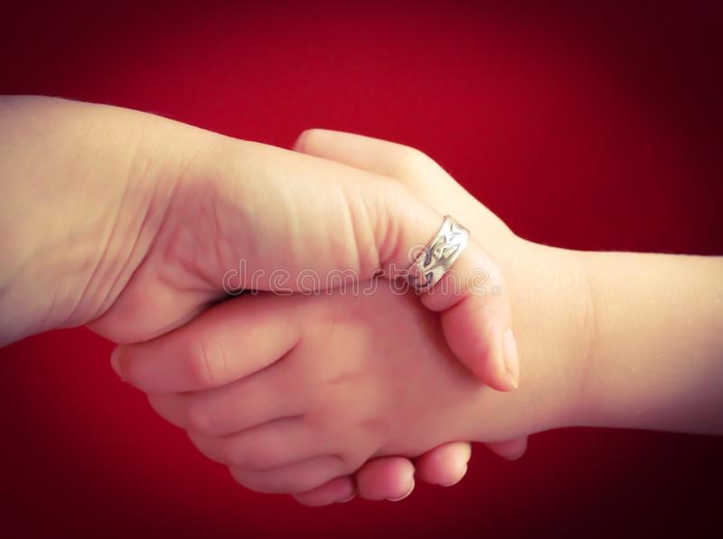 Family agreement. Mother and child handshake stock images