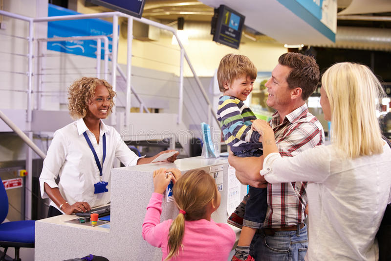 Family At Airport Check In Desk Leaving On Vacation royalty free stock image